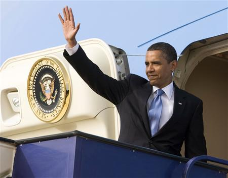 U.S. President Barack Obama waves before leaving for Cairo at King Khalid International Airport in Riyadh